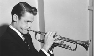 Chet Baker, posed, with trumpet, 1955. (Photo by Harry Hammond/V&A Images/Getty Images)